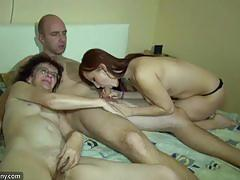 Filthy amateurs sucking cock in threesome