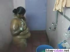 Fat indian chick takes a shower on hidden cam
