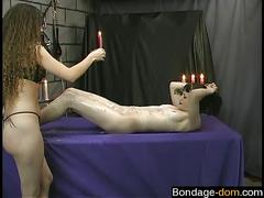 Curly femdom waxes her slave in her dungeon