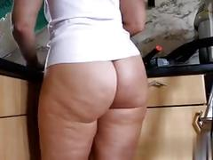 Mature milf shows off her big ass around the house