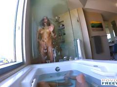 Hot babe showering while her boyfriend masturbates
