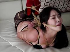 Chinese hot babe in tight rope bondage and ballgagged
