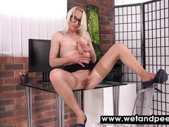 Hot blonde toys her pussy and rolls around in pee