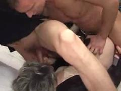 Mature woman teaching two younger guys