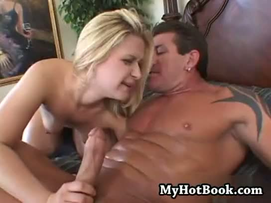 Aaralyn barra relaxes outside  leaning back on the