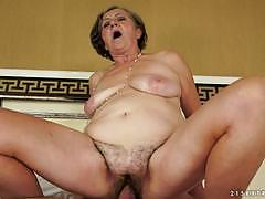 Old lady gets a stiff cock in her hairy pussy