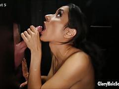 Seductive babe sucking cock at gloryhole