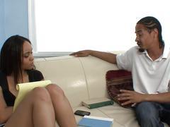 Cute black girl blows black cock on the sofa