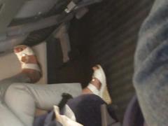 German candid shoe dangle in train