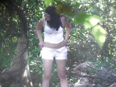 Girl in white shorts panties peeing in forest while smoking