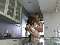 Japanese babe with amazing tits is surprised in the kitchen