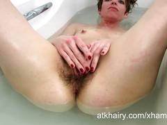 Maria washes her hairy bush in the soapy water