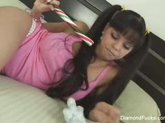 Hot latina diamond kitty sticks a candy cane in her pussy