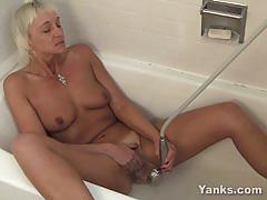 Horny milf masturbating in the bathtub