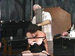 Two old guys torture mature brunette in dungeon