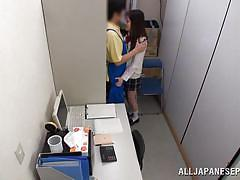 Japanese cutie jacks off cock in the backroom