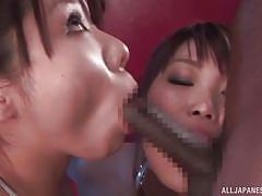 Japanese cuties share cum from a black cock