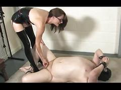 Sexy latex mistress dominating her slave