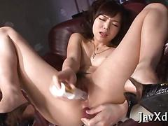 Stuffing her wet pussy with a sex toy deep