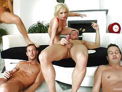 Blondie sucks on a bunch of hard cocks