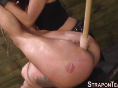 Screaming lesbian slave gets fingered and toyed in a threesome