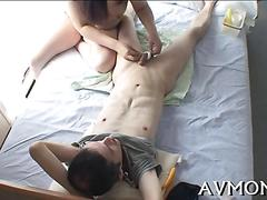 Bound dude gets dominated by a japanese milf on camera