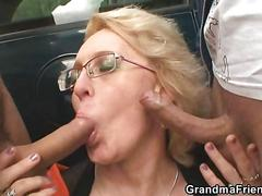 Granny swallows two cocks in the fields