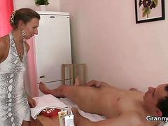 Mature masseuse sucks and rides young meat movie