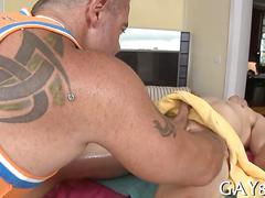 Tattooed masseur strips and fucks his sexy client