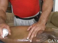 Mature masseur blows an oiled up dude on a massage table