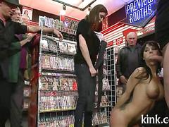 Bound fake tits brunette dominated in a store in public