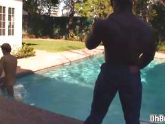 Sucking a big black dick in the poolside