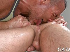 Oiled up straight guy lets his masseur take his cock