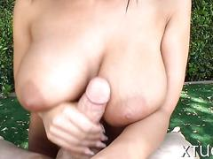 Busty brunette has a fat dick she is gobbling on