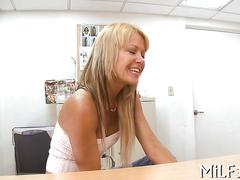 Sexy blonde milf gets her face creamed in an office