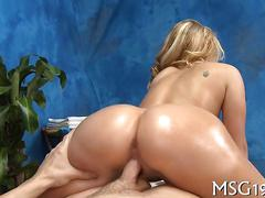 Blonde devours a big dick on a massage table and fucks