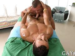 Oiled up dude has a hot cock to give out