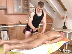 Tattooed stud fucks his masseur standing up and oiled