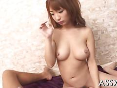 Trimmed japanese honey licks balls and fucks in a threesome