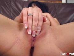 She fingers her wet shaved pussy