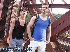 Two studs suck dick in a busy bridge for cash