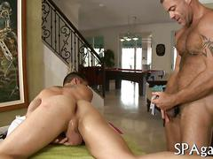 Tattooed manly man bangs his straight client during a massage
