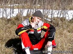 Twink snowboarder lays down in the snow to jerk off and smoke