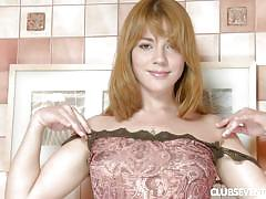 Redheaded cutie rubs her soft clit