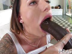 Sexy bitch dines on a fat black cock and fucks