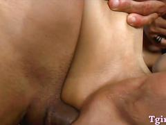 Two pretty shemales have sex with horny bald dude on the bed
