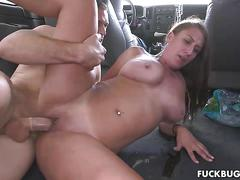 Big tit girl takes her clothes off