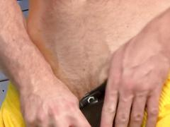 Muscular manly man rubs his cock in a locker room