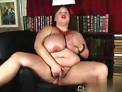 Chubby chick with red cheeks teases with big tits on camera