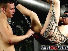 Blindfolded twink toyed in a chain sex swing
